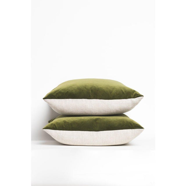 """Green velvet pillows with oatmeal linen backing and zipper closure. Sold individually. Dimensions: 22""""x22""""."""