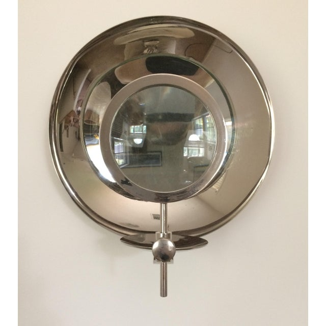 This lovely industrial modern and functional candle holder wall sconce with its heavy, solid, adjustable magnifying glass...