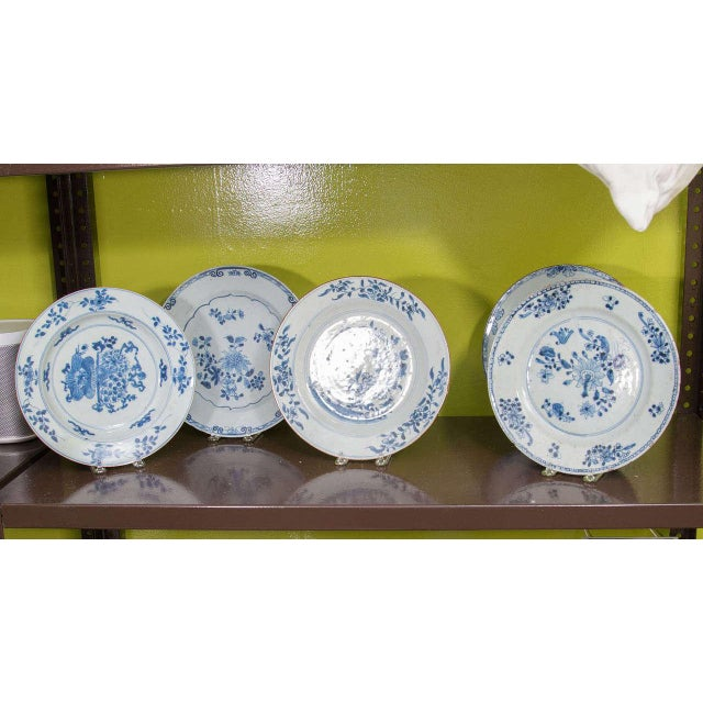 A set of blue and white Chinese export porcelain plates, each with a different scene, 19th century. Priced separately.