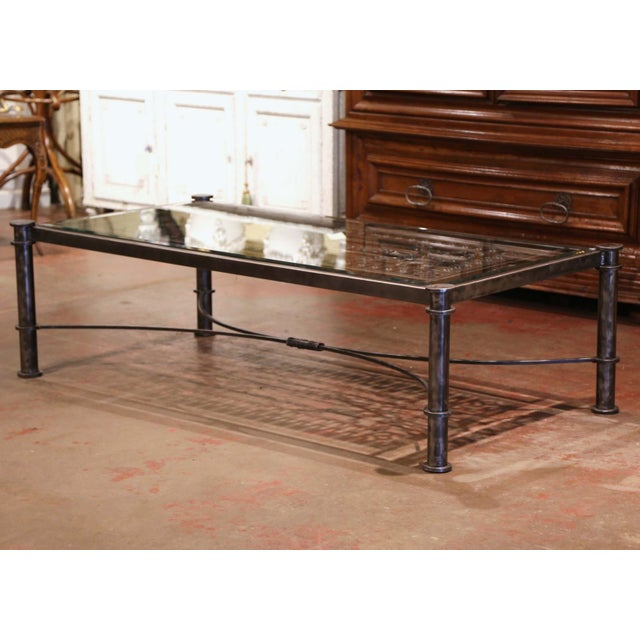 Decorate a den or a formal living room with this important coffee table; built using an ornate, antique gate from France,...