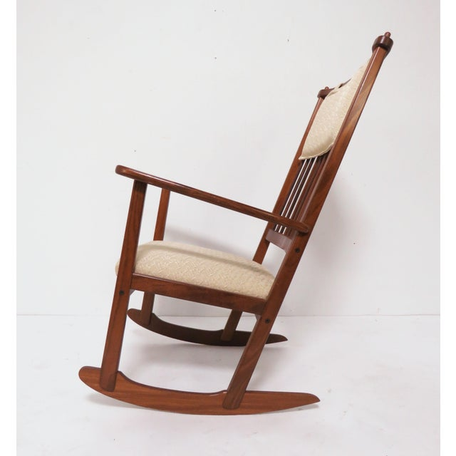 A Scandinavian rocking chair with original upholstery and head cushion designed by Yngve Ekstrom for Swedese, made in...