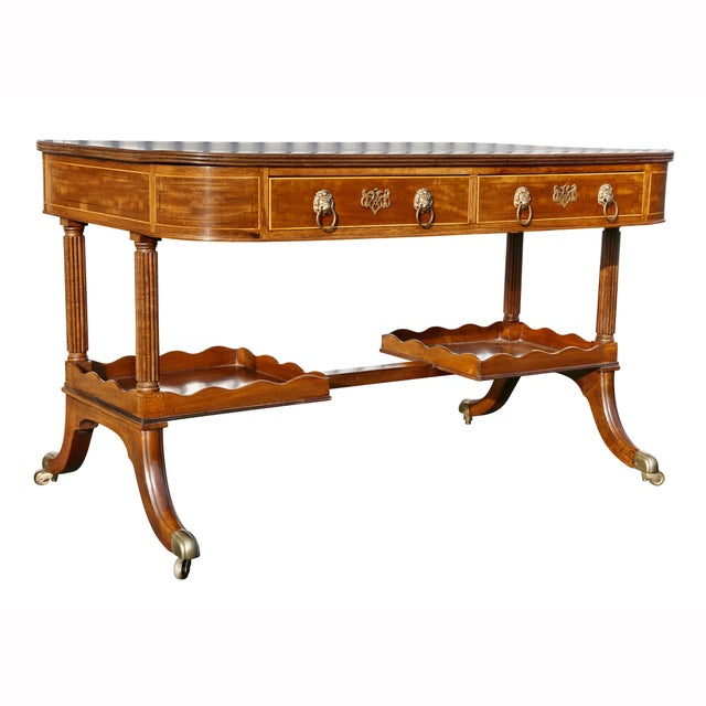 Rectangular top writing table with inset tooled black leather top and rosewood cross banding over a pair of drawers with...