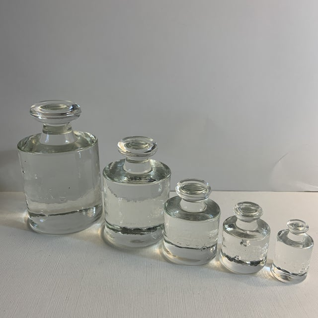 Wonderful vintage glass metric calibration set. To catch light in your windows or for table top display. Unusual decor item!