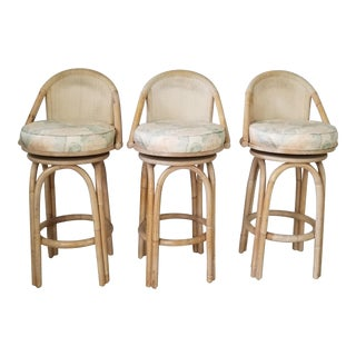 Set of Three Vintage Bamboo and Cane Back Swivel Bar Stools . For Sale