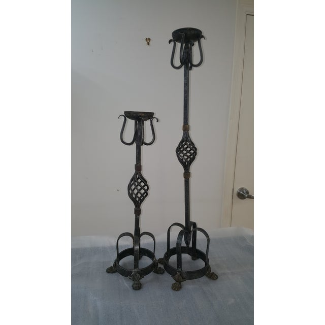 """2 Theodore Alexander Candle Holders Antiqued Iron From Vietnam Larger one is 10""""wide 35.5"""" High Smaller one is 9"""" Wide 24""""..."""
