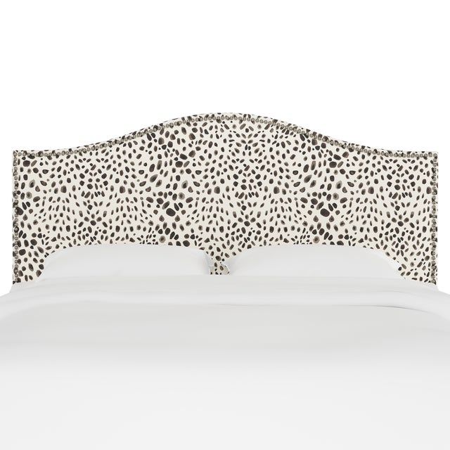Give your interior a lift with the Headboard. Featuring the delicate curves of a classic camelback design, with subtle...