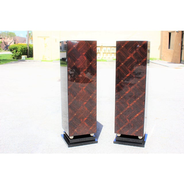 Beautiful pair of French Art Deco exotic Macassar ebony mother-of-pearl accents pedestals, circa 1940s. Square geometric...