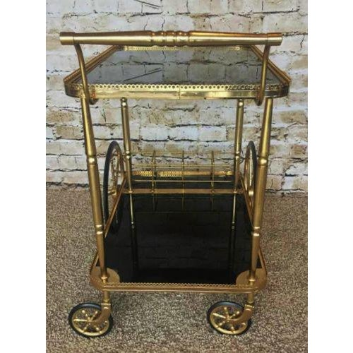 Brass Hollywood Regency Maison Bagues Brass & Black Glass Tea Trolley For Sale - Image 7 of 9