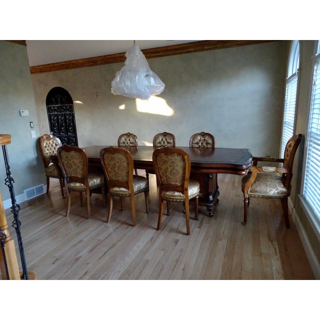 Stunning Italian style table with immense attention to details. 8 chairs included.