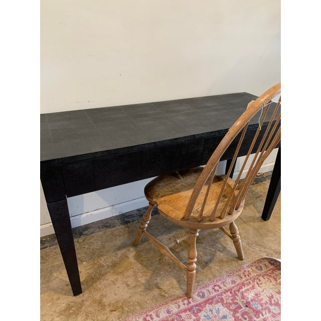 Sleek and sophisticated black faux shagreen desk equipped w two easy opening drawers. No hardware. This desk is from Made...