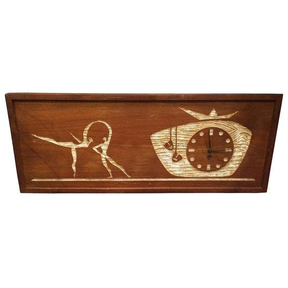 Non-working Mid-Century Modern carved cork wall clock. The clock features a carved out clock design with a dancing couple...
