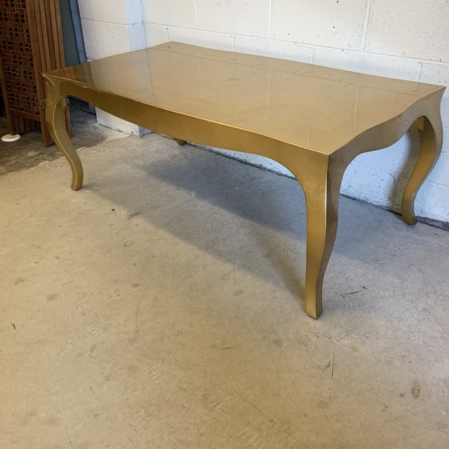 If you were searching for this, you already know what it is! Fabulous gold leaf, solid wood cocktail table with cabriolet...