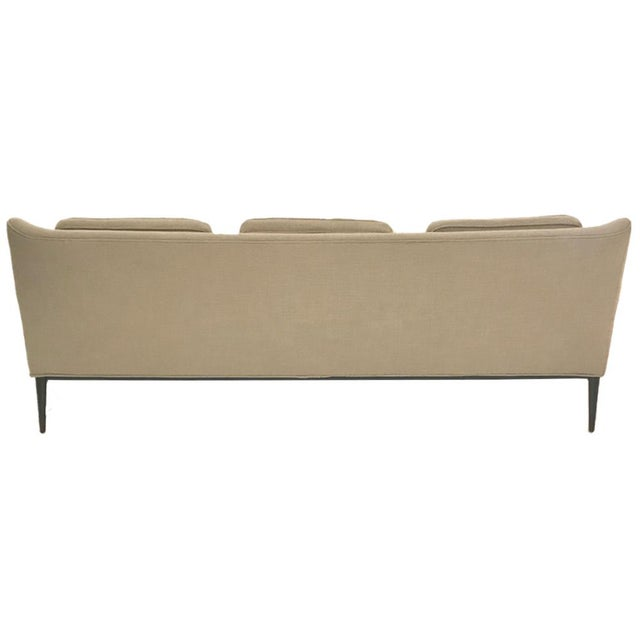 Paul McCobb sofa model 1307 for Directional features a slight winged back resting on a black lacquered maple frame that...