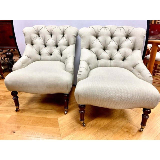 Elegant and comfortable Ralph Lauren button tufted chairs upholstered in a gray beige woven fabric. Legs are mahogany with...