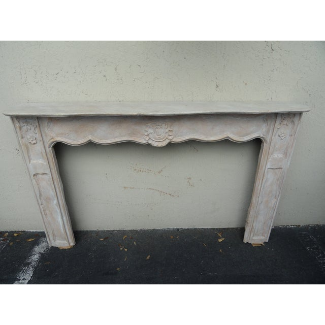 19th century French wood hand carved fireplace surround. Walnut and oak. One-piece, 20th century finish. Large scale....