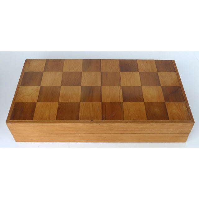 Offered for sale is a huge & substantial chess set which has a wooden case and 32 large and heavy plaster pieces. The case...