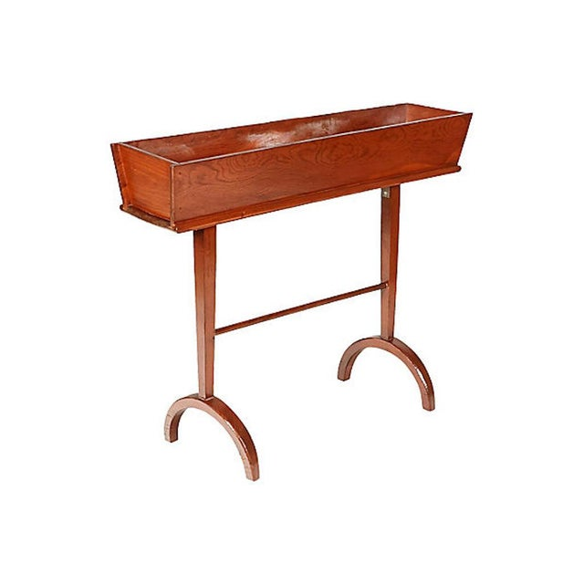 "1960s rectangular planter stand with half-circle feet. Planter, 8""L x 5.5""W. No maker's mark."