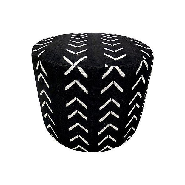 Our custom hand-built ottoman upholstered in authentic tribal hand-spun with raised seam channels of textured natural mud...