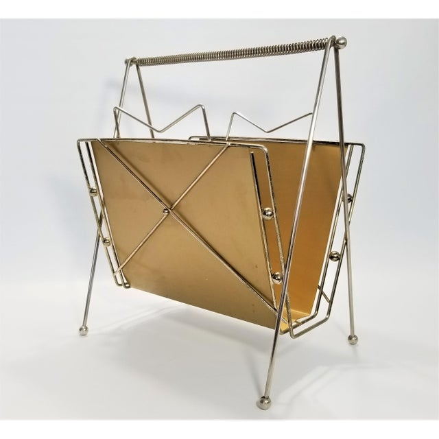 Offering a rare authentic Atomic Metal Magazine Holder, circa 1950s. This incredible magazine holder clearly illustrates...