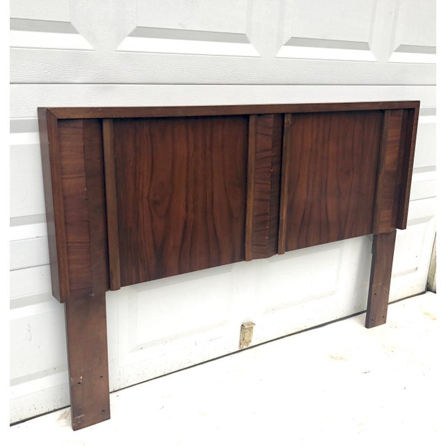 Vintage walnut headboard measures sixty two inches wide and is made to fit a queen size bed. Unique mid-century modern...