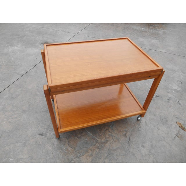I have a rare vintage mid-century Danish modern flip top teak serving cart / table on casters for easy moving. This cart...