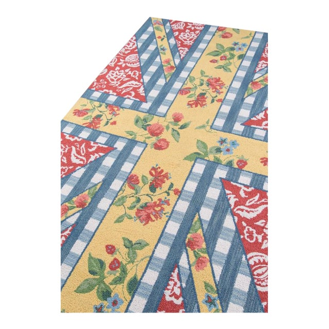 Anglophiles are sure to swoon over the patriotic pattern play of this indoor area rug. Hand hooked from natural wool...