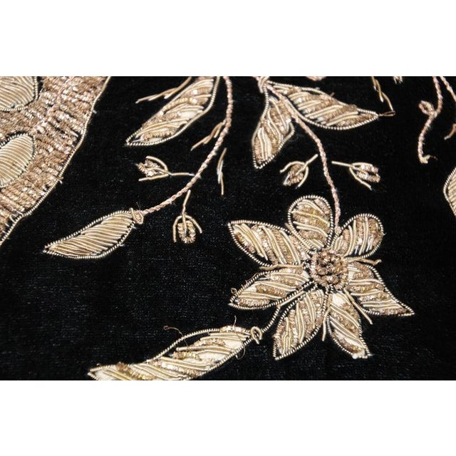 Black silk velvet pillow hand embroidered with gold metallic threads and sequins depicting a royal peacock on a branch....