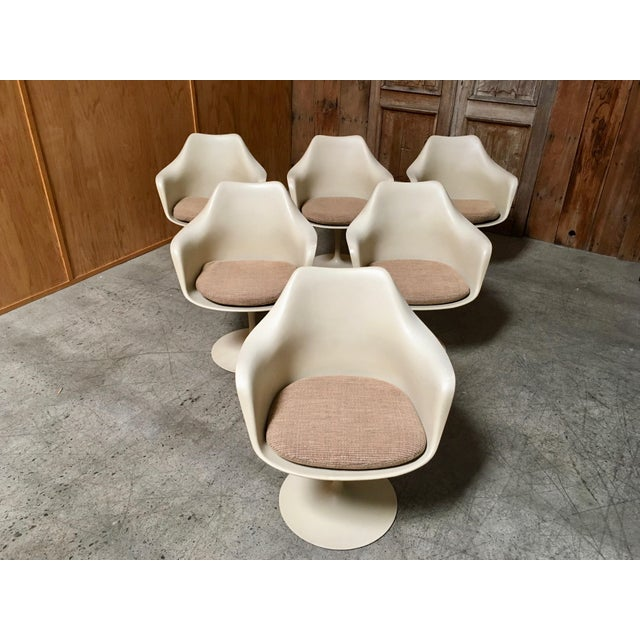 """Dining or game tulip swivel armchairs. by Eero Saarinen for Knoll Each chair measures: 26"""" wide x 24"""" deep x 32"""" tall Seat..."""