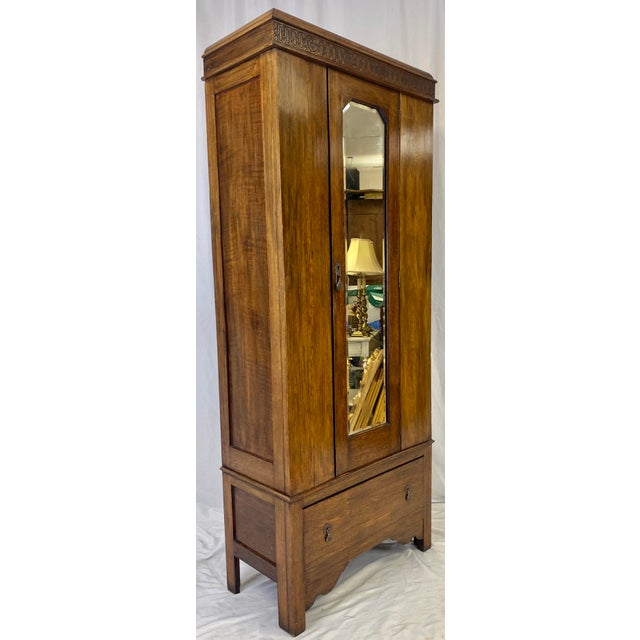 Antique English Hall Wardrobe Armoire featuring Hand Carved Details on the Cornice, Beveled Full Length Mirror, Original...