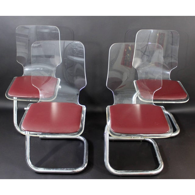 For your consideration is a fantastic set of four, Lucite and tubular chrome, side dining chairs, by Hill Manufacturing...