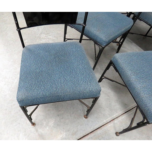 Set of 10 vintage black metal dining or side chairs with blue upholstered seats. Circa Mid 20th Century.