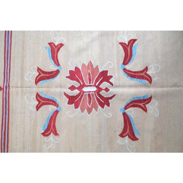 Handmade vintage Bessarabian kilim from Romania in cream beige and red colours. Vegetable dyes, the rug is in original...