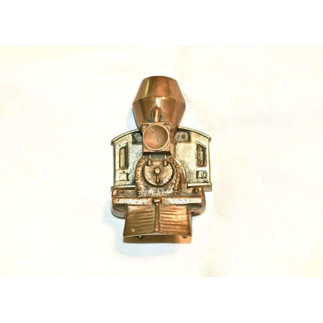 Locomotive train door knocker of solid brass. Works well with a resonant knock. Suitable for interior or exterior doors....