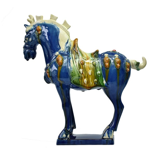 A beautiful blue horse in high gloss. This wonderful piece has all the hallmarks of Tang San Cai terracotta potteries with...
