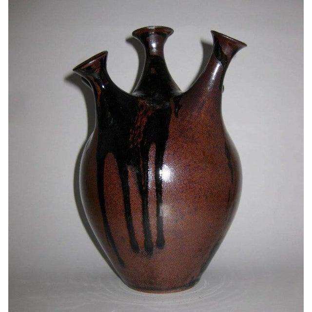 Studio art pottery, five chimney, weed pot sculptural vase. The vase has a deep, rich, brown underglaze and a deep black...