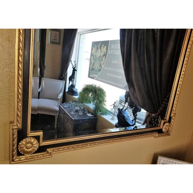 PRESENTING a lovely Louis XVI Style Giltwood & Ebony Beveled Glass Mirror. Very nice size …. not too large but not too...