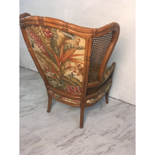 This great classic wingback is cane with a beautiful Palm print upholstery. Comfortable and elegant!