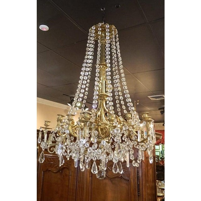 French Bronze Dore Eighteen Candle Chandelier with Strands of Crystal, 19th Century. Includes a Bronze Dore Canopy. Not...