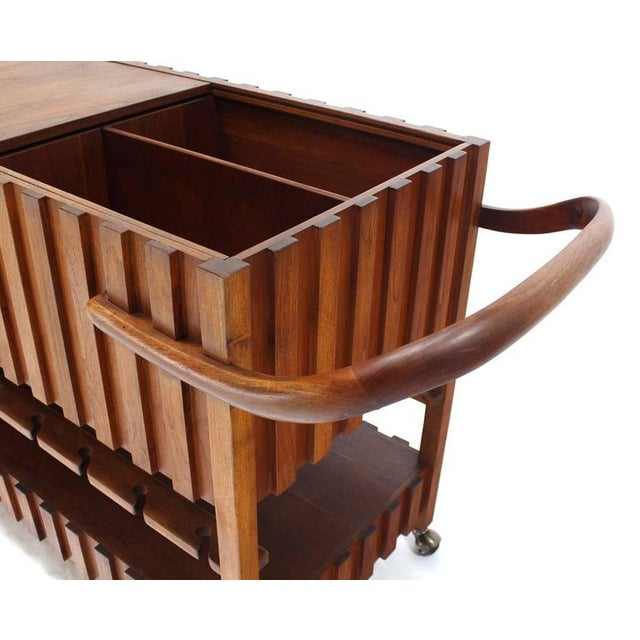 Very nice solid oiled walnut mid century modern bar cart in style of Adrian Pearsall. Circa mid 20th century.