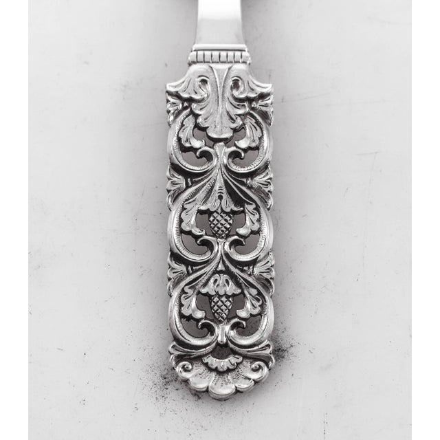 This sterling silver server is just lovely. It has a heavy gauge and solid feel in your hand. The handle is based on Art...