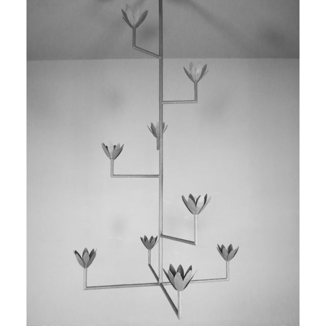 Nine flowers and nine lights white plaster and steel multi armed pendant chandelier with a white enamel finish. May...
