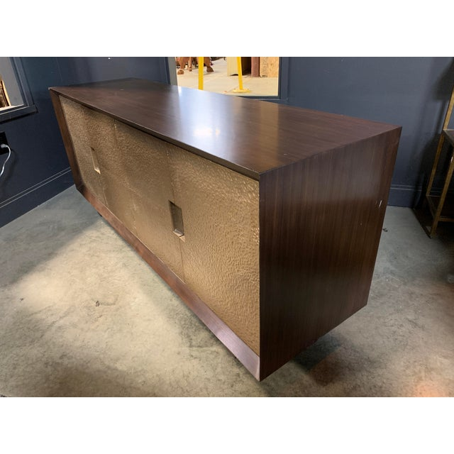 Worlds Away Credenza With A Wood Frame And Hammered Metal Doors.