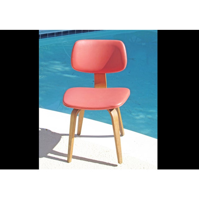 "A rare Thonet bent plywood upholstered vinyl chair from the 1960s in a bright cheerful coral! The seller says: ""We found..."