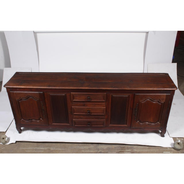 "Antique Louis XV-Style Country French buffet constructed of antique oak featuring a monumental 96"" width, double paneled..."
