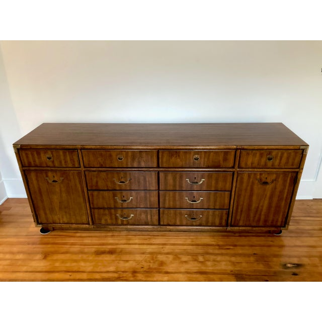 This Drexel Accolade ten drawer Campaign credenza with brass faux bamboo hardware corners and inset drawer and cabinet...