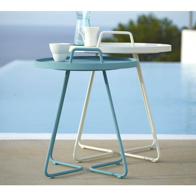 Cane-line and the Danish design team Strand+Hvass decided to make a smaller version of the side table that could both be...