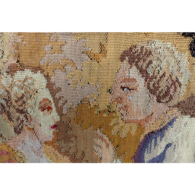 Offered for sale in an early 20th century European hand woven wool tapestry created in the Aubusson style. The textile has...
