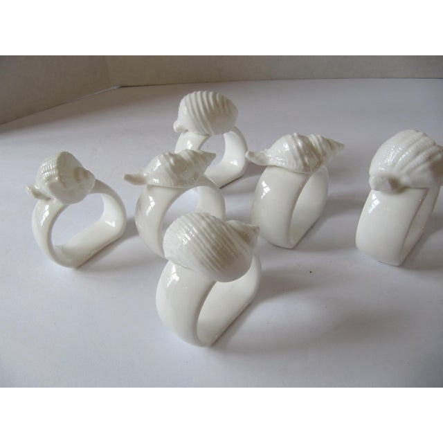 Beautiful vintage white porcelain napkin rings with shells, six pieces. Perfect for your summer party. Ask about combined...