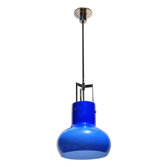 Blue with internal white internal cased glass from Studio Venini design production. Studio Venini's designs exude a modern...