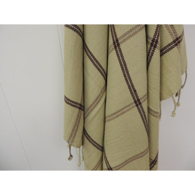 Woven green and brown Himalayan Cashmere Throw with Hand-knotted fringes Brown and green plaid woven pattern. Size: 43 x...